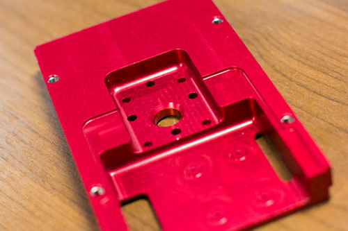Red anodized CNC Machined part made of metal