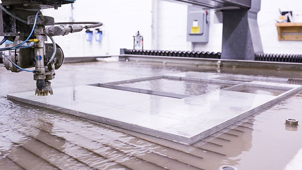 A waterjet machine preparing to cut aluminum